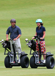 Two people riding X2 Golfs